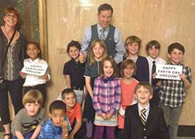 Representative Rob Nosse with s percipitatedchool children who testified in favor of HB 2605