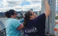Volunteers removing graffiti on Steele Bridge